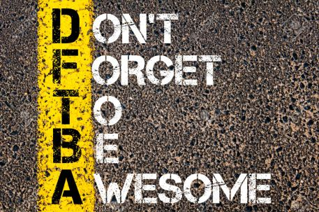 Chat Acronym DFTBA as Don't Forget To Be Awesome. Yellow paint line on the road against asphalt background. Conceptual image